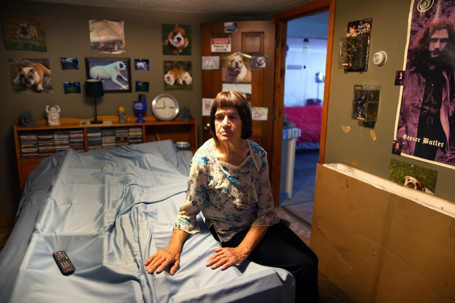Carmela Correia, 73, in the basement bedroom used by her son, Paul. The schizophrenia patient was 45 when he died after being strapped to a bed at Bridgewater State Hospital.